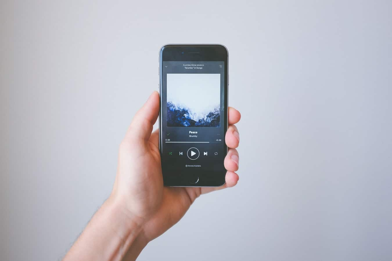 photo of person holding a phone with Spotify