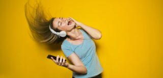 Photo of a woman listening to music and dancing